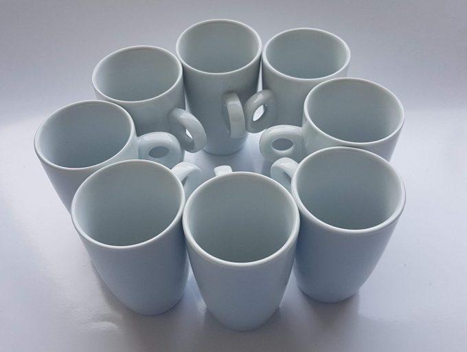 Porcelaines M.P. Samie. Union Limousine France. Espressokopje wit porselein. Met kenmerkend rond handvat. Per stuk. 2
