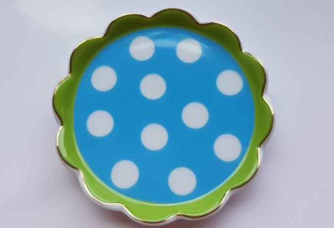 Oilily made for Douwe Egberts. Thee tip rond met polka dot. Blauw groen. Golfrand.  Per stuk. 1