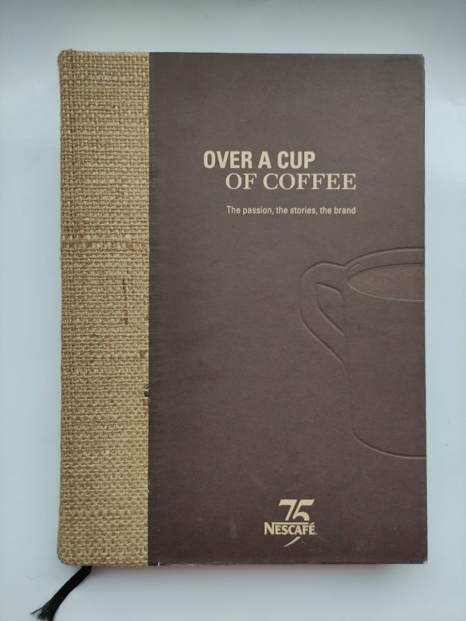 75 Years Nescafé. Over a Cup of Coffee. The passion , the stories, the brand. Boek 1
